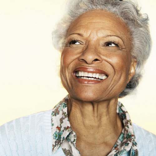Mature Black woman smiling with beautiful dental implants from Dr. Hilton Israelson in Richardson, TX