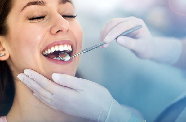 Woman getting a periodontal exam at Dr. Hilton Israelson in Richardson, TX